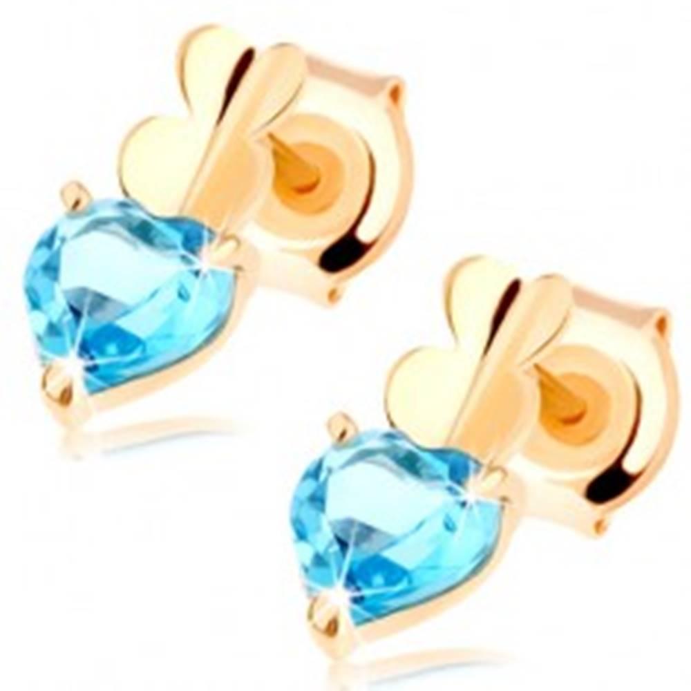 Šperky eshop Zlaté náušnice 375 - dve malé srdiečka a srdiečkový topás modrej farby