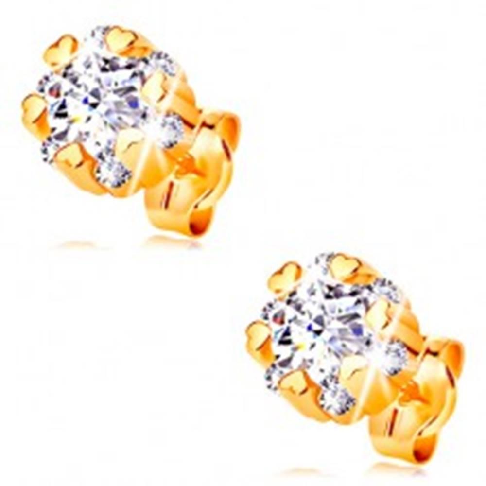 Šperky eshop Zlaté 14K náušnice - žiarivý kvet čírej farby a drobné lesklé srdiečka