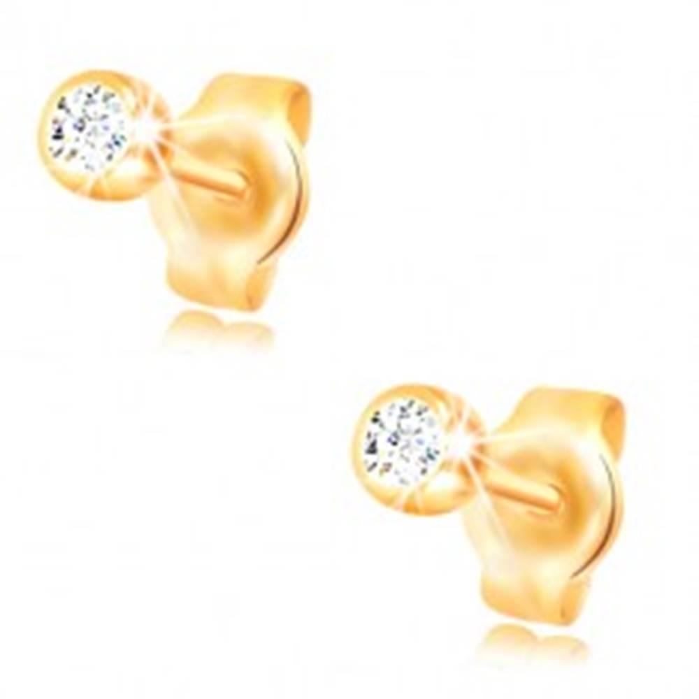 Šperky eshop Náušnice v žltom 14K zlate - okrúhly číry zirkón v lesklej objímke, 3 mm