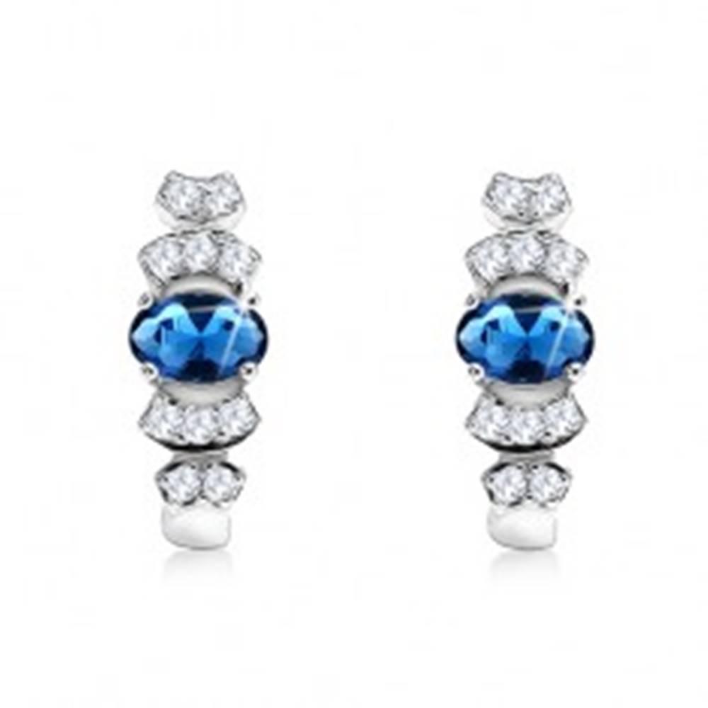 Šperky eshop Strieborné 925 náušnice s oválnym modrým kameňom, oblé línie čírych zirkónikov