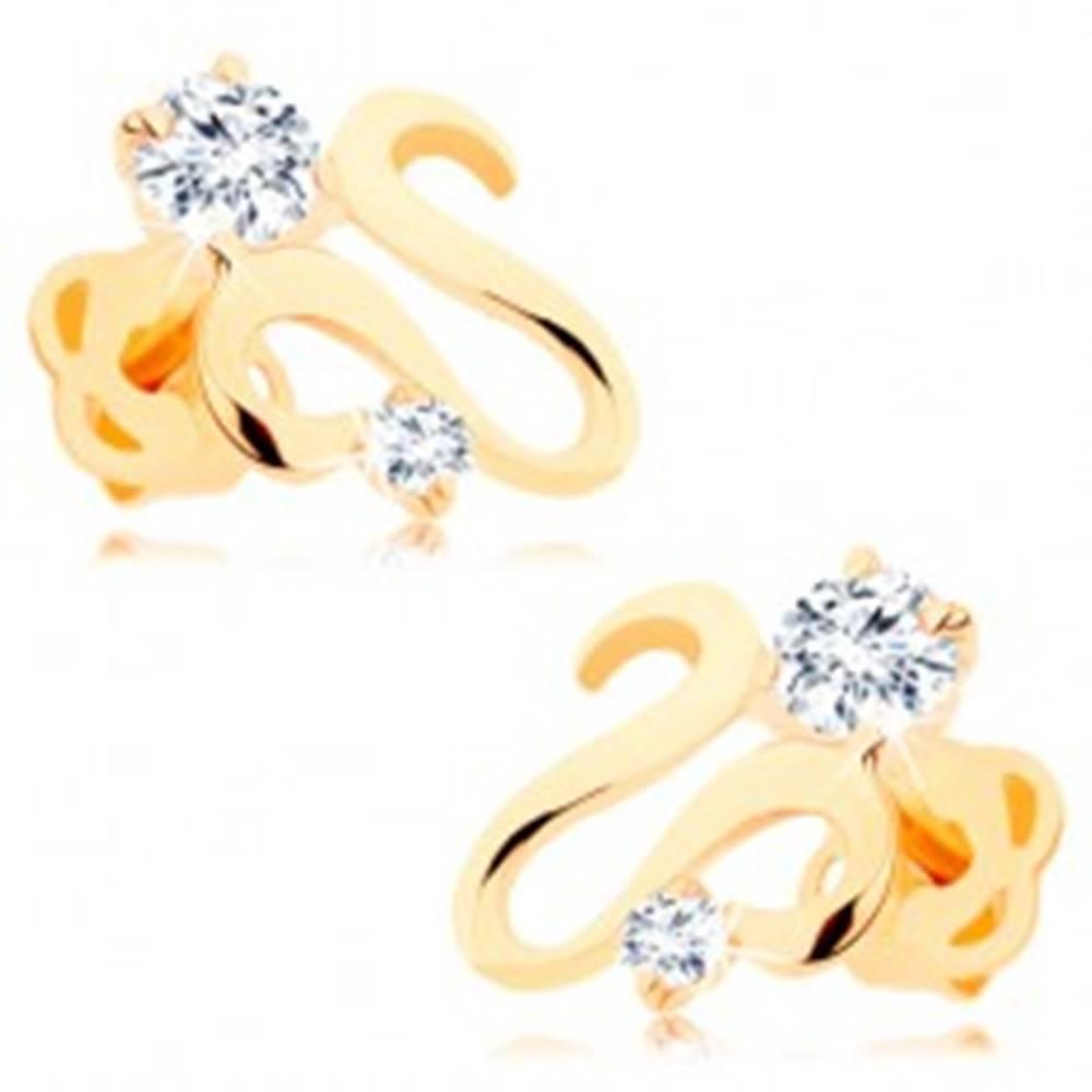 Šperky eshop Náušnice v žltom 14K zlate - lesklá zvlnená stuha, dva zirkóny čírej farby