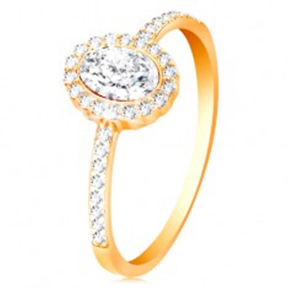 Šperky eshop Prsteň zo žltého 14K zlata - oválny zirkón s ligotavým lemom, zdobené ramená - Veľkosť: 50 mm