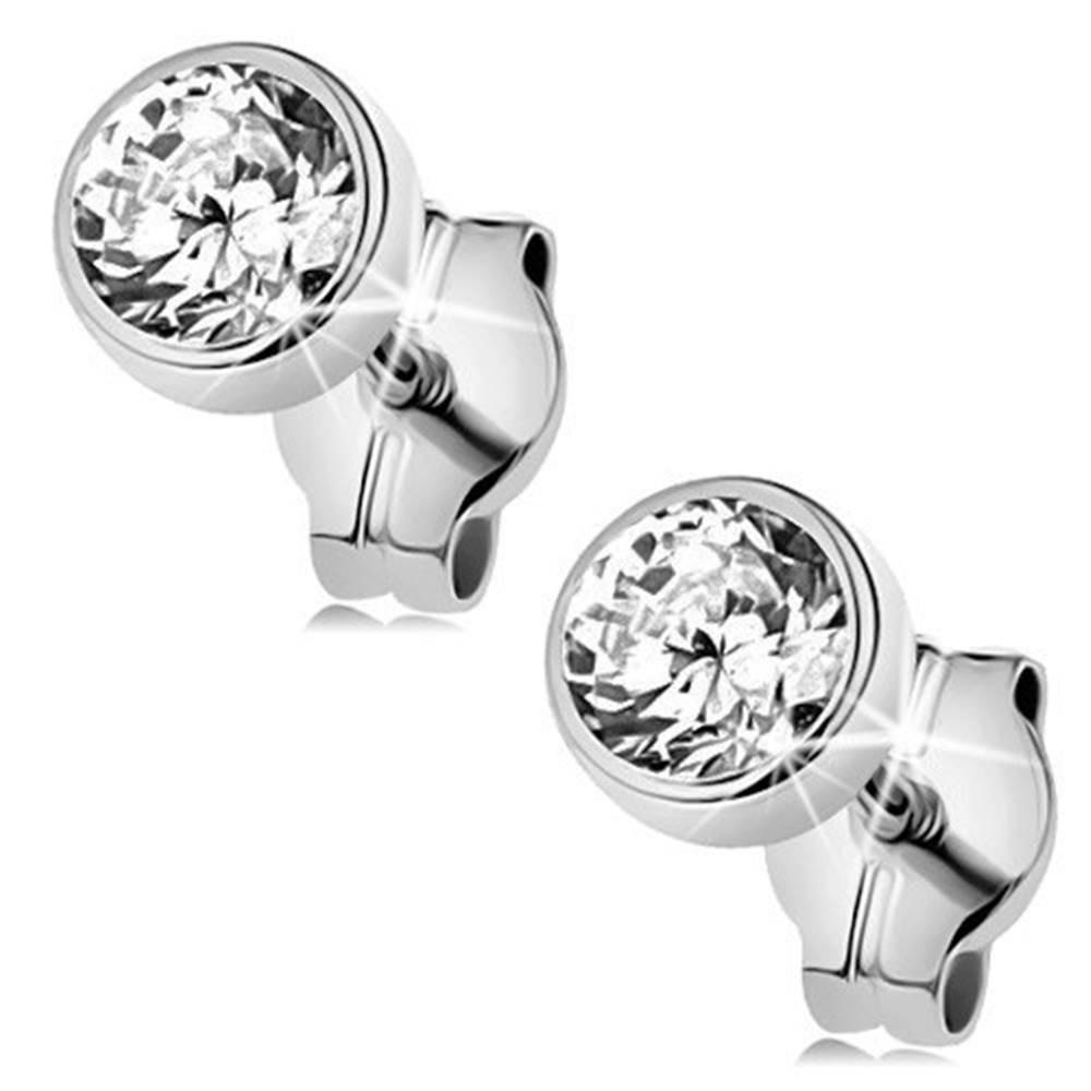 Šperky eshop Náušnice z bieleho 9K zlata - okrúhly ligotavý zirkón v objímke, 4 mm